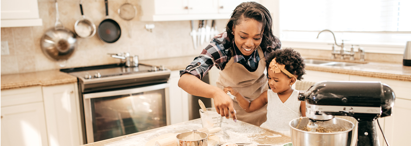 Mother and daughter baking in a newly remodeled kitchen.